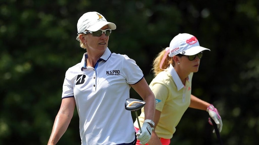 Karrie Webb, of Australia, watches her tee shot along with Paula Creamer, right, on the 13th tee during the second round of the KPMG Women's PGA golf championship at Westchester Country Club, Friday, June 12, 2015, in Harrison, N.Y.  (AP Photo/Adam Hunger)