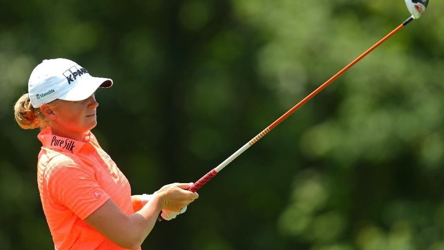 Stacy Lewis watches her tee shot on the 13th hole during the second round of the KPMG Women's PGA golf championship at Westchester Country Club, Friday, June 12, 2015, in Harrison, N.Y.  (AP Photo/Adam Hunger)