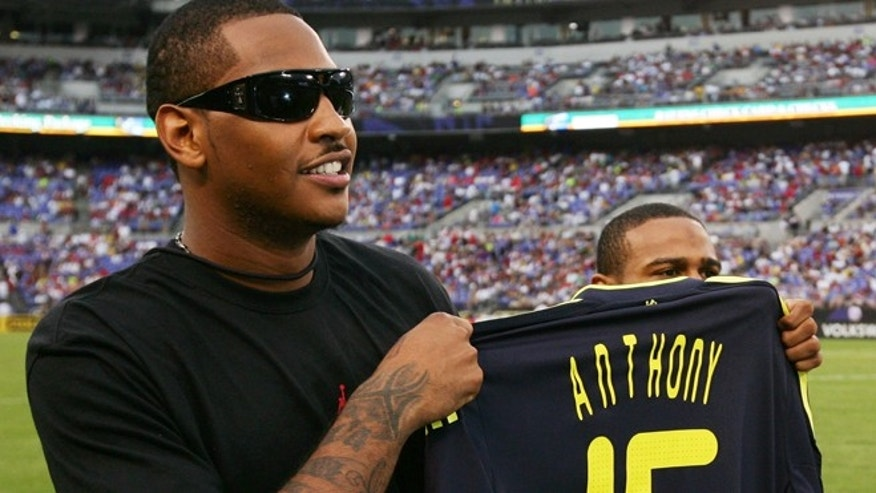 BALTIMORE - JULY 24: NBA player Carmelo Anthony holds up a personalized Chelsea FC jersey before the game between AC Milan and Chelsea FC at M & T Bank Stadium on July 24, 2009 in Baltimore, Maryland. (Photo by Ned Dishman/Getty Images) *** Local Caption *** Carmelo Anthony