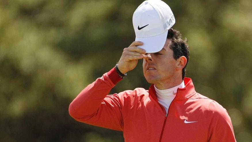 FILE - In this May 28, 2015, file photo, Northern Ireland's Rory McIlroy looks dejected after missing a putt on the ninth hole during the first round of the Irish Open Golf Championship at Royal County Down, Newcastle, Northern Ireland. Returning to the site of what McIlroy considers one of his breakthrough tournaments, the 2010 PGA Championship at Whistling Straits, might give the world's top-ranked golfer an extra confidence boost going into next week's U.S. Open at Chambers Bay in Washington.  (AP Photo/Peter Morrison, File)
