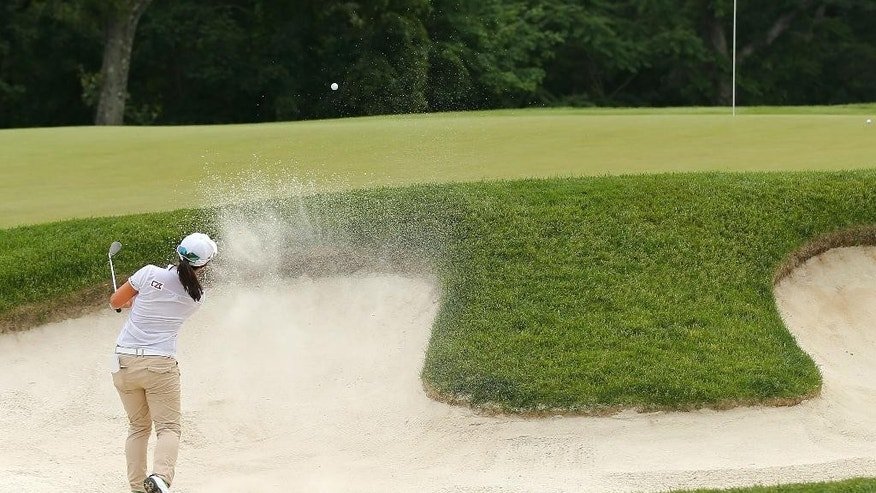 Sei Young Kim, of South Korea, hits out of a bunker onto the 10th green during the second round of the KPMG Women's PGA golf championship at Westchester Country Club, Friday, June 12, 2015, in Harrison, N.Y.  (AP Photo/Adam Hunger)