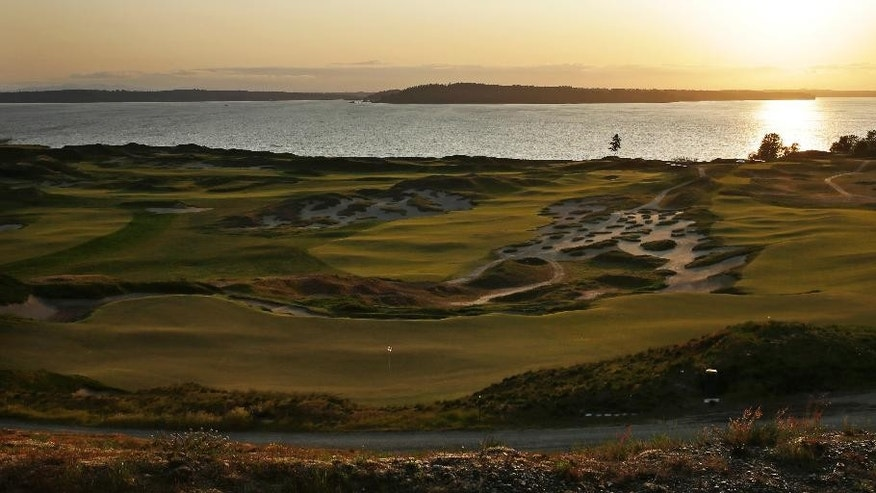 In this April 29, 2015, photo, Chambers Bay golf course is shown at sunset in University Place, Wash. Chambers Bay will host the 115th U.S. Open golf tournament next week, but the course is a mystery to the majority of the players because it opened only eight years ago. (AP Photo/Ted S. Warren)