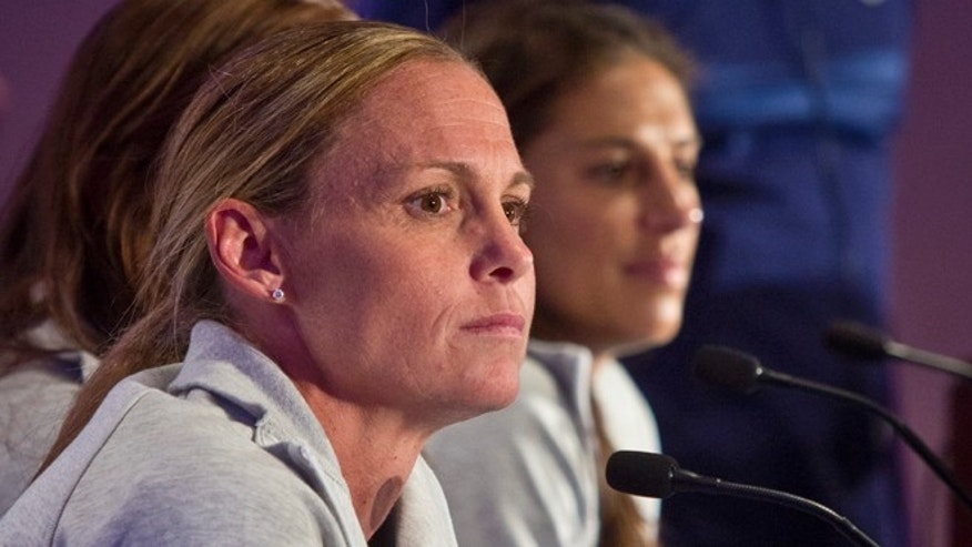 U.S. women's soccer players Christie Rampone, left, and Carli Lloyd, right, listens during U.S. Women's National Team World Cup media day, Wednesday, May 27, 2015, in New York. The U.S. women will face South Korea on Saturday, May 30 at Red Bull Arena in their final send-off match, before leaving for Canada and the 2015 FIFA Women's World Cup. (AP Photo/Bebeto Matthews)