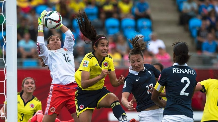 Colombia's goal keeper Sandra Sepulveda makes a save against France during the first half of a FIFA Women's World Cup soccer game in Moncton, New Brunswick, Canada, on Saturday, June 13, 2015. (Andrew Vaughan/The Canadian Press via AP) MANDATORY CREDIT