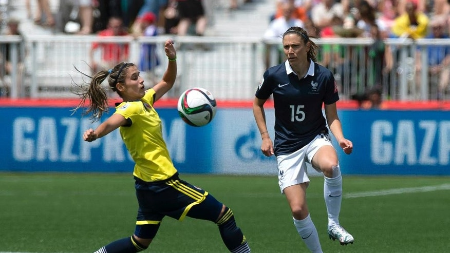 France's Elise Bussaglia, right, and Colombia's Daniela Montoya battle for the ball during the first half of a FIFA Women's World Cup soccer game in Moncton, New Brunswick, Canada, on Saturday, June 13, 2015. (Andrew Vaughan/The Canadian Press via AP) MANDATORY CREDIT