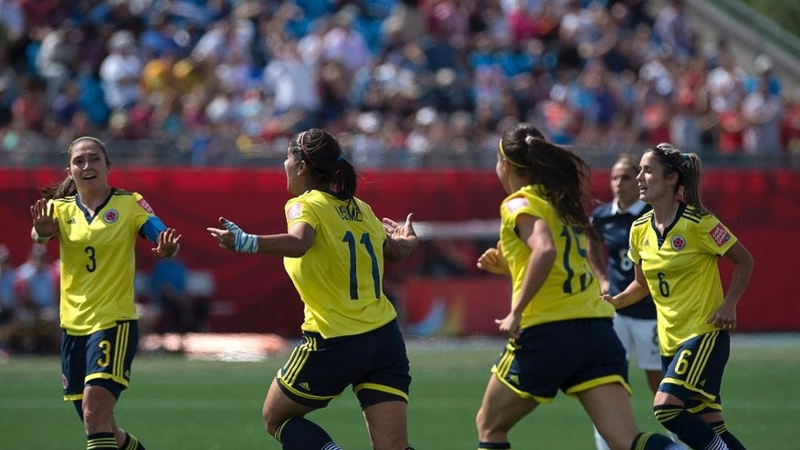 Colombia celebrates their second goal against France during the second half of a FIFA Women's World Cup soccer game in Moncton, New Brunswick, Canada, on Saturday, June 13, 2015. (Andrew Vaughan/The Canadian Press via AP) MANDATORY CREDIT