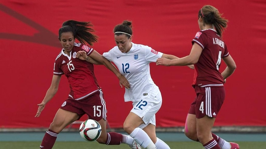 England's Lucy Bronze battles Mexico's Bianca Sierra, left, and Alina Garciamendez during the first half of a FIFA Women's World Cup soccer game in Moncton, New Brunswick, Canada, on Saturday, June 13, 2015. (Andrew Vaughan/The Canadian Press via AP) MANDATORY CREDIT