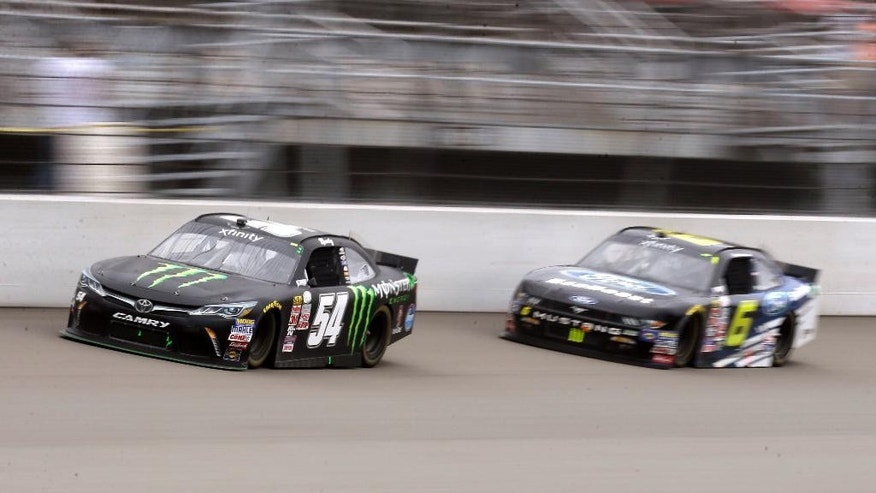 Kyle Busch (54) leads Darrell Wallace Jr. (6) during the NASCAR Xfinity series auto race at Michigan International Speedway, Saturday, June 13, 2015, in Brooklyn, Mich. (AP Photo/Carlos Osorio)