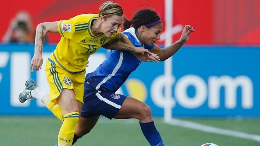 Sweden's Therese Sjogran (15) and United States' Sydney Leroux chase down the ball during first-half FIFA Women's World Cup soccer game action in Winnipeg, Manitoba, Canada, Friday, June 12, 2015. (John Woods/The Canadian Press via AP) MANDATORY CREDIT