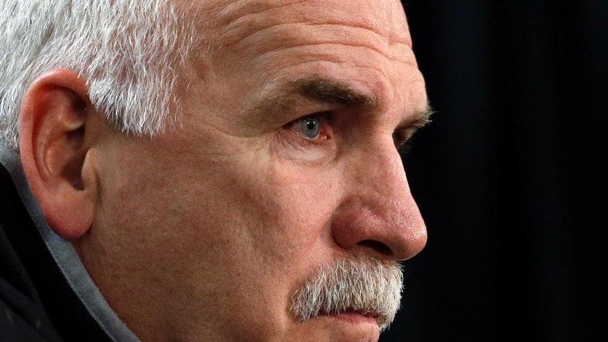 Chicago Blackhawks head coach Joel Quenneville listens to questions during a news conference, Sunday, June 14, 2015, in Chicago. The Chicago Blackhawks now lead the series 3-2 and have the opportunity to win the Cup at home for the first time since 1938. Game 6 is scheduled for Monday. (AP Photo/Nam Y. Huh)