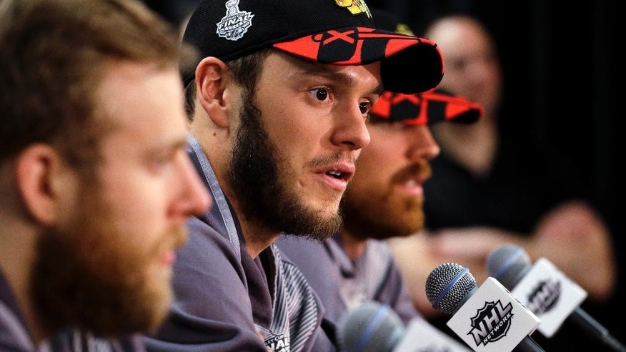 Chicago Blackhawks center Jonathan Toews talks during a news conference, Sunday, June 14, 2015, in Chicago. The Chicago Blackhawks now lead the series 3-2 and have the opportunity to win the Cup at home for the first time since 1938. Game 6 is scheduled for Monday. (AP Photo/Nam Y. Huh)
