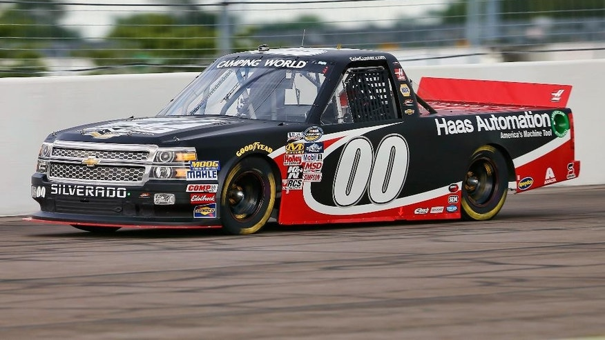 Cole Custer (00) makes his way around the track during qualifying for the NASCAR Truck Series auto race at Gateway Motorsports Park, Saturday, June 13, 2015, in Madison, Ill. (AP Photo/Scott Kane)