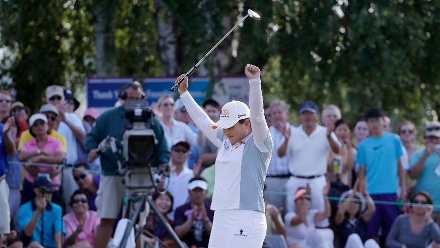Inbee Park, of South Korea, celebrates after winning the KPMG Women's PGA golf championship at Westchester Country Club in Harrison, N.Y., Sunday, June 14, 2015. (AP Photo/Julio Cortez)