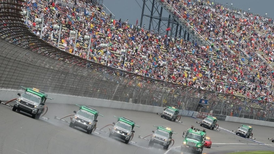 Air Titans dry the track during the NASCAR Sprint Cup series auto race at Michigan International Speedway, Sunday, June 14, 2015, in Brooklyn, Mich. (AP Photo/Bob Brodbeck)