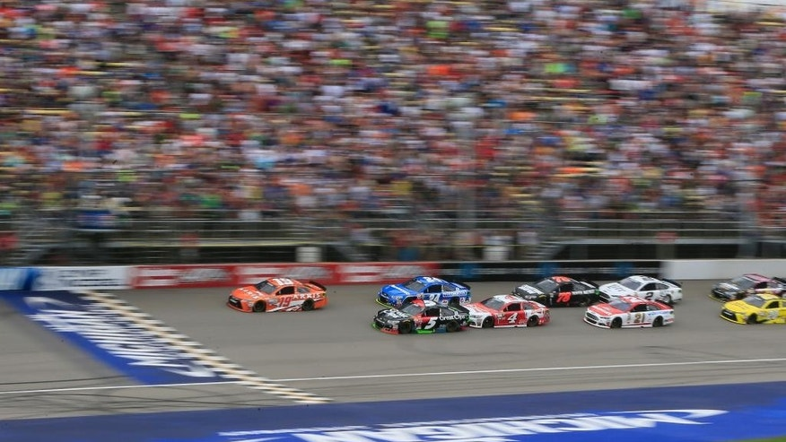 Drivers approach the start line on a restart during during the NASCAR Sprint Cup series auto race at Michigan International Speedway, Sunday, June 14, 2015, in Brooklyn, Mich. (AP Photo/Carlos Osorio)