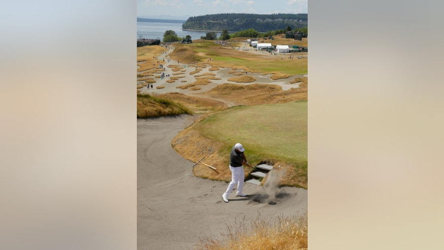 Shane Lowry, of Ireland, hits out of the bunker on the fourth hole during a practice round for the U.S. Open golf tournament at Chambers Bay on Monday, June 15, 2015 in University Place, Wash. (AP Photo/Ted S. Warren)