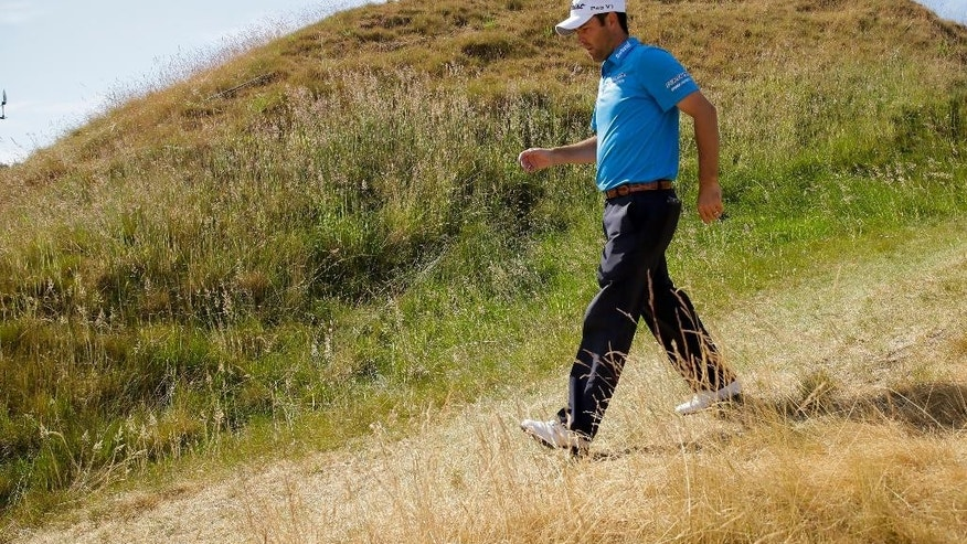 Robert Streb walks to the 11th tee during a practice round for the U.S. Open golf tournament at Chambers Bay, Monday, June 15, 2015, in University Place, Wash. (AP Photo/Ted S. Warren)