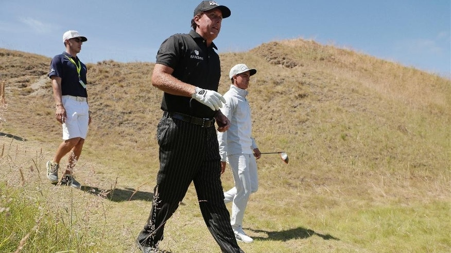 Rickie Fowler, right, and Phil Mickelson walk on the 11th hole during a practice round for the U.S. Open golf tournament at Chambers Bay on Tuesday, June 16, 2015 in University Place, Wash. (AP Photo/Charlie Riedel)