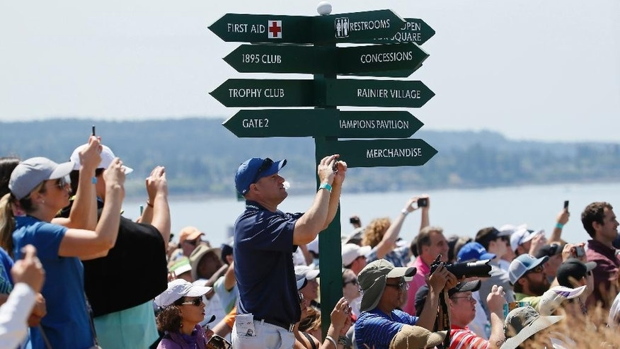 Fans watch as Phil Mickelson plays a practice round for the U.S. Open golf tournament at Chambers Bay on Tuesday, June 16, 2015 in University Place, Wash. (AP Photo/Matt York)