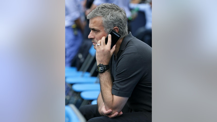 Chelsea soccer manager Jose Mourinho waits for the start of the men's singles tennis match between Spain's Rafael Nadal and Ukraine's Alexandr Dolgopolov at Queen's tennis championship in London, Tuesday June 16, 2015. (AP Photo/Tim Ireland)
