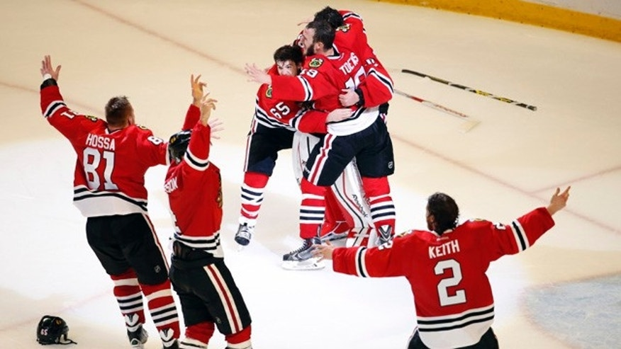 June 15, 2015: Members of the Chicago Blackhawks celebrate after defeating the Tampa Bay Lightning in Game 6 of the Stanley Cup Final seriesin Chicago. The Blackhawks defeated the Lightning 2-0 to win the series 4-2. (AP Photo/Charles Rex Arbogast)