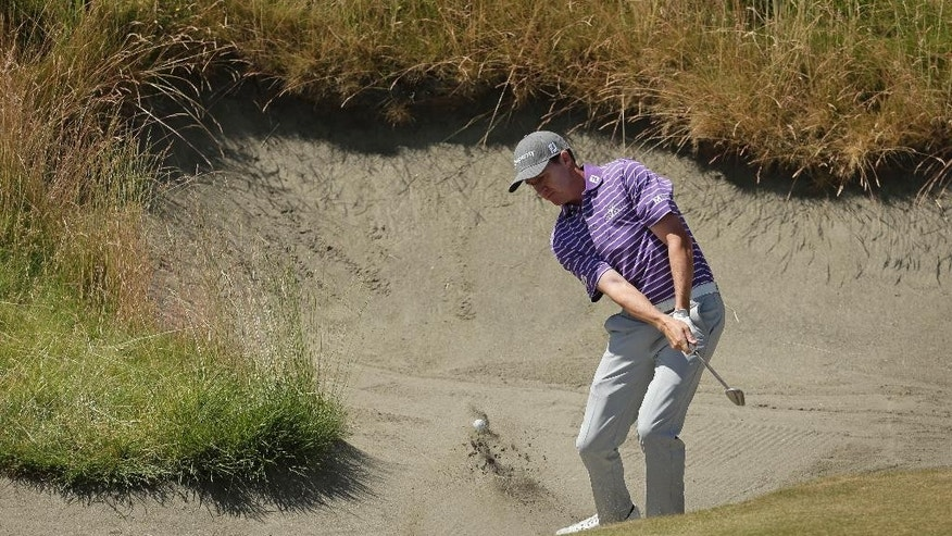 Jimmy Walker hits out of the bunker on the 10th hole during a practice round for the U.S. Open golf tournament at Chambers Bay on Tuesday, June 16, 2015 in University Place, Wash. (AP Photo/Charlie Riedel)