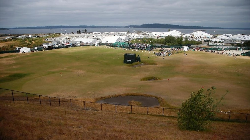 Players warm up on the range during during a practice day for the U.S. Open golf tournament at Chambers Bay on Tuesday, June 16, 2015 in University Place, Wash. (AP Photo/Lenny Ignelzi)