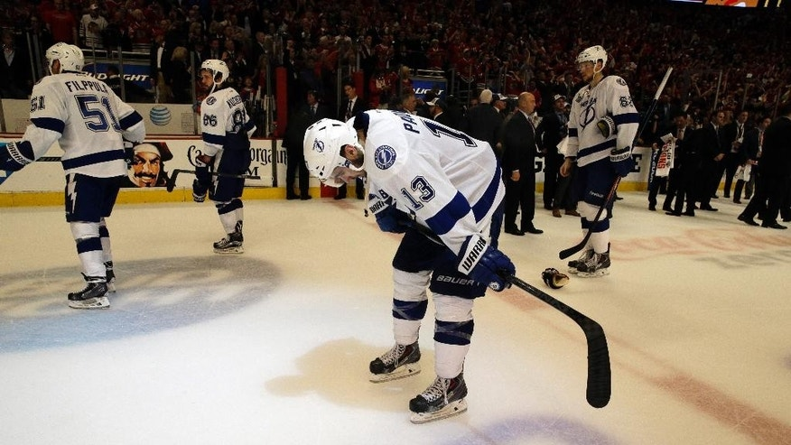 Tampa Bay Lightning center Cedric Paquette (13) reacts after Game 6 of the NHL hockey Stanley Cup Final series against the Chicago Blackhawks on Monday, June 15, 2015, in Chicago. The Blackhawks won 2-0 to take the series 4-2. (AP Photo/Nam Y. Huh)