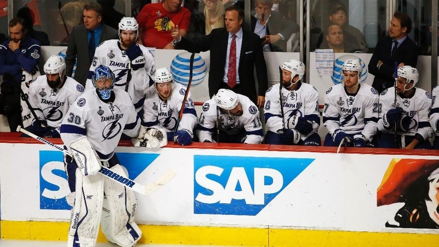 Tampa Bay Lightning goalie Ben Bishop (30) stands with his teammates during a timeout in the third period in Game 6 of the NHL hockey Stanley Cup Final series against the Chicago Blackhawks on Monday, June 15, 2015, in Chicago. (AP Photo/Charles Rex Arbogast)