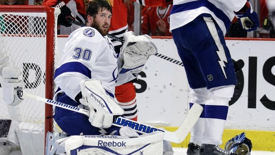Tampa Bay Lightning goalie Ben Bishop looks off after losing his helmet during the second period in Game 6 of the NHL hockey Stanley Cup Final series against the Chicago Blackhawks on Monday, June 15, 2015, in Chicago. (AP Photo/Nam Y. Huh)