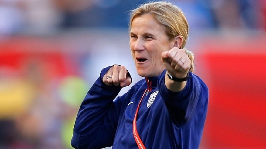 Head coach Jill Ellis of the United States watches her team warm up on June 12, 2015 in Winnipeg, Canada.