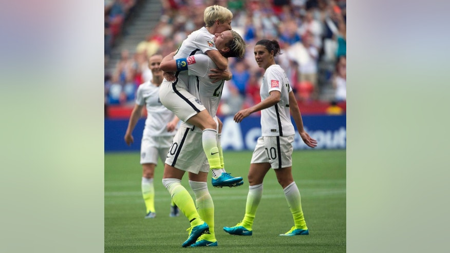 United States' Abby Wambach celebrates her goal with teammate Megan Rapinoe during the first half of a FIFA Women's World Cup soccer match against Nigeria, Tuesday, June 16, 2015 in Vancouver, New Brunswick, Canada (Jonathan Hayward/The Canadian Press via AP) MANDATORY CREDIT
