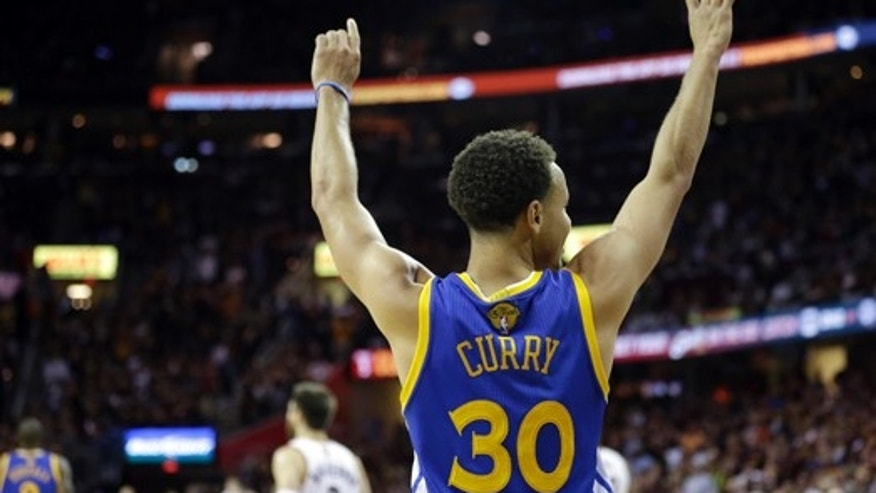 June 16, 2015: Golden State Warriors guard Stephen Curry (30) celebrates during the second half of Game 6 of basketball's NBA Finals against the Cleveland Cavaliers in Cleveland. The Warriors defeated the Cavaliers 105-97 to win the best-of-seven game series 4-2. (AP Photo/Tony Dejak)