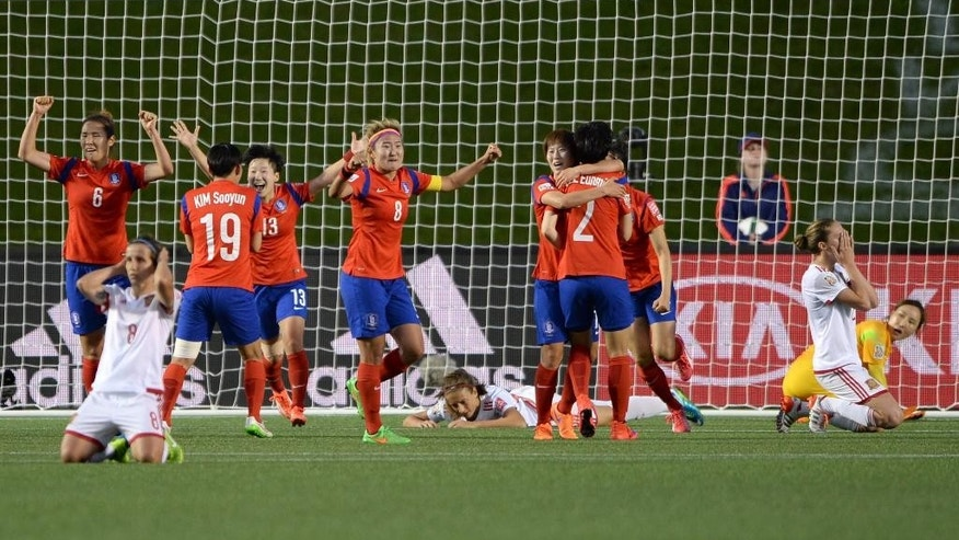 South Korea players celebrate as a free kick from Spain's Sonia Bermudez (8) goes over the net in the last seconds of the second half of a FIFA Women's World Cup soccer match, Wednesday, June 17, 2015 in Ottawa, Ontario, Canada,  (Sean Kilpatrick/The Canadian Press via AP) MANDATORY CREDIT