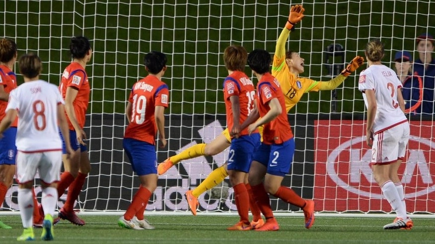 South Korea players watch as a free kick from Spain's Sonia Bermudez goes over the net in the last seconds of the second half of a FIFA Women's World Cup soccer match, Wednesday, June 17, 2015 in Ottawa, Ontario, Canada,  (Sean Kilpatrick/The Canadian Press via AP) MANDATORY CREDIT