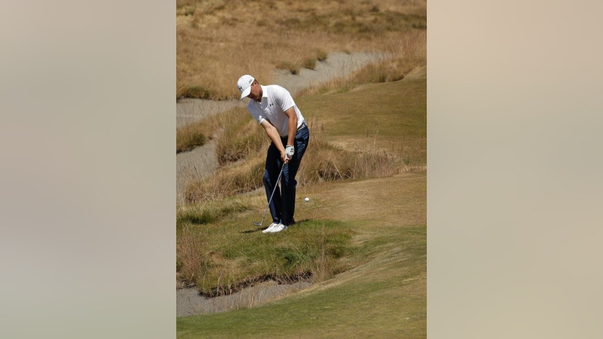 Jordan Spieth hits a chip on the 16th hole during a practice round for the U.S. Open golf tournament at Chambers Bay on Wednesday, June 17, 2015 in University Place, Wash. (AP Photo/Charlie Riedel)
