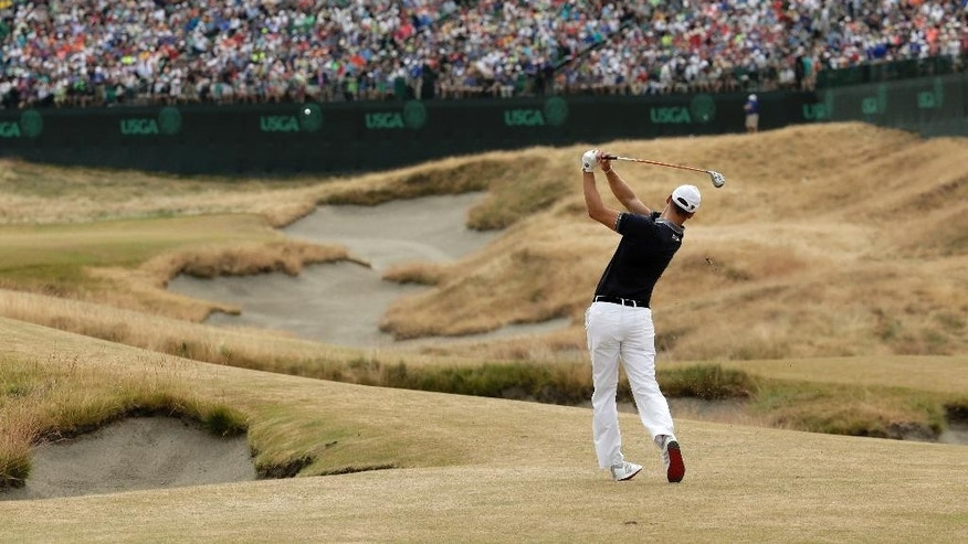 Martin Kaymer, of Germany, hits from the fairway on the 18th hole during the first round of the U.S. Open golf tournament at Chambers Bay on Thursday, June 18, 2015 in University Place, Wash. (AP Photo/Charlie Riedel)