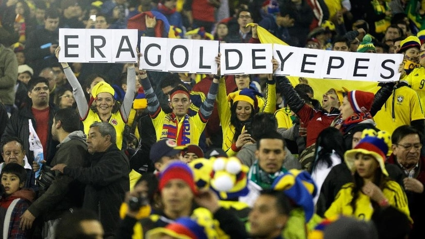 "Colombia supporters hold signs with the sentence""it was Yepes' goal"" before a Copa America Group C soccer match against Brazil at the Monumental stadium in Santiago, Chile, Wednesday, June 17, 2015. The sentence refers to a controversial goal scored by Colombia's player Mario Alberto Yepes scored against Brazil that was disallowed during the 2014 World Cup. (AP Photo/Natacha Pisarenko)"