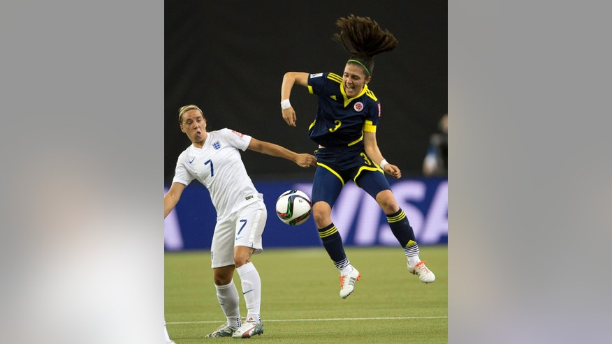 England's Jordan Nobbs, left, and Colombia's Natalia Gaitan go after a loose ball during the first half of a Women's World Cup soccer match Wednesday, June 17, 2015, in Montreal. (Ryan Remiorz/The Canadian Press via AP)