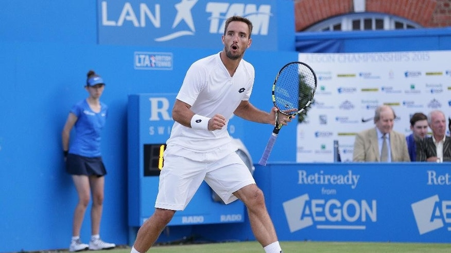 Serbia's Viktor Troicki celebrates taking the second set from Croatia's Marin Cilic during their singles tennis match at the Queen's Championships in London, Thursday, June 18, 2015. (AP Photo/Tim Ireland)