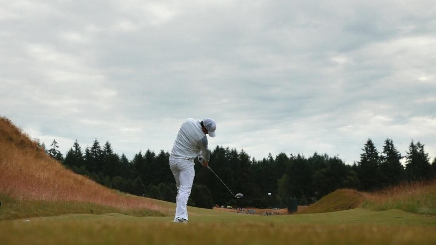 Rory McIlroy, of Northern Ireland, watches his tee shot on the 13th hole during the first round of the U.S. Open golf tournament at Chambers Bay on Thursday, June 18, 2015 in University Place, Wash. (AP Photo/Charlie Riedel)