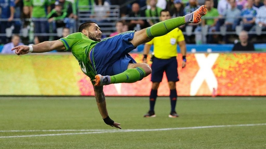 FILE - In this May 27, 2015 file photo, Seattle Sounders' Clint Dempsey takes a bicycle kick shot on goal against the Colorado Rapids in the second half of an MLS soccer match, in Seattle. Dempsey has been suspended for three games by Major League Soccer and fined for his conduct toward a match official during a U.S. Open Cup match this week, a penalty the U.S. captain will finish serving before the Americans start the defense of their CONCACAF Gold Cup title next month.(AP Photo/Ted S. Warren, File)