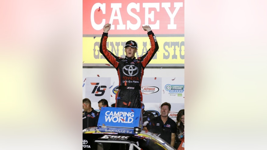 Erik Jones celebrates in victory lane after winning the NASCAR Truck Series auto race, Friday, June 19, 2015, at Iowa Speedway in Newton, Iowa. (AP Photo/Charlie Neibergall)