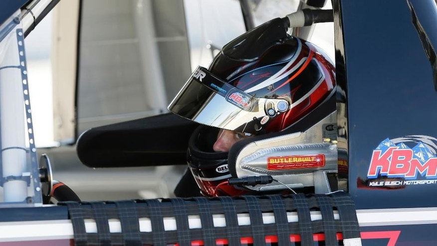 Erik Jones sits in his car during qualifying for the NASCAR Truck Series auto race, Friday, June 19, 2015, at Iowa Speedway in Newton, Iowa. (AP Photo/Charlie Neibergall)