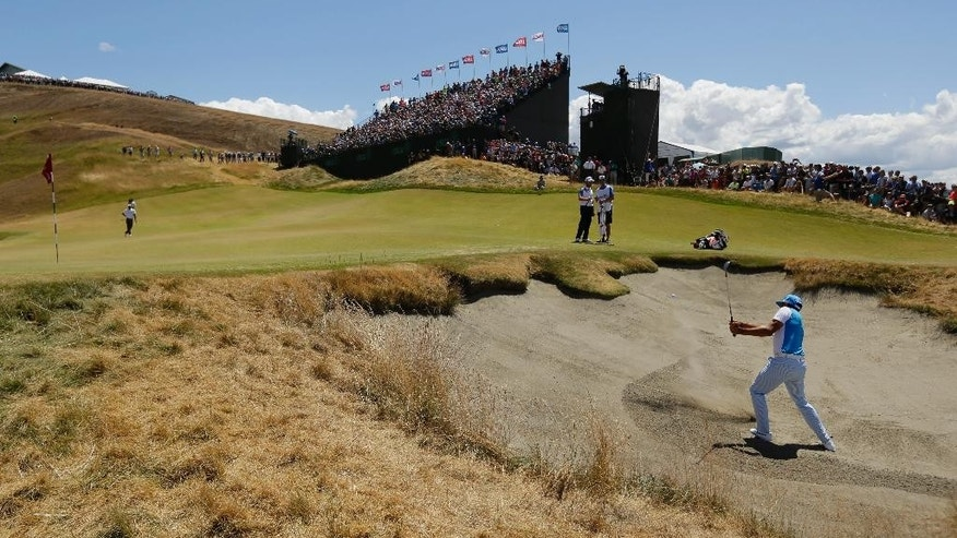 Rickie Fowler hits out of the bunker on the ninth hole during the second round of the U.S. Open golf tournament at Chambers Bay on Friday, June 19, 2015 in University Place, Wash. (AP Photo/Ted S. Warren)