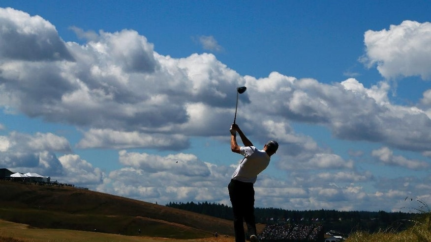 Brian Campbell, amateur, watches his tee shot on the eighth hole during the second round of the U.S. Open golf tournament at Chambers Bay on Friday, June 19, 2015 in University Place, Wash. (AP Photo/Matt York)