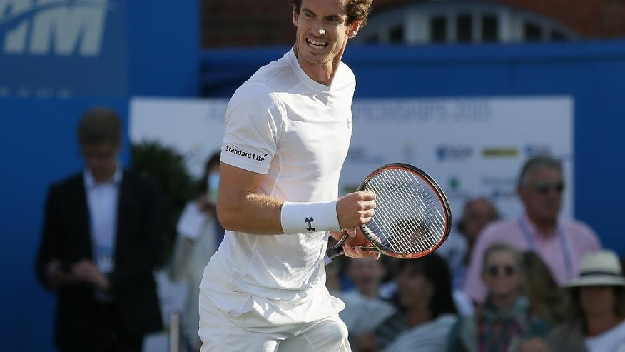 Britain's Andy Murray celebrates taking a point from Luxembourg's Gilles Muller during their quarterfinal tennis match on the fifth day of the Queen's Championships in London, Friday, June 19, 2015. (AP Photo/Tim Ireland)