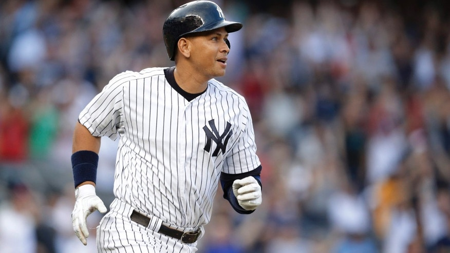 June 19, 2015: New York Yankees' Alex Rodriguez watches his home run, his 3,000th career hit, during the first inning of a baseball game against the Detroit Tigers.