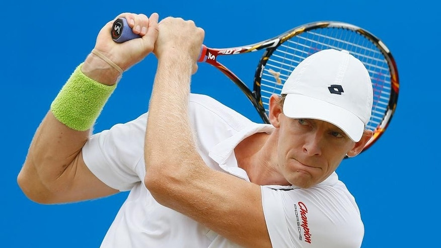Kevin Anderson of South Africa plays a return to Gilles Simon of France  during their semifinal tennis match at the Aegon Championships in London, Saturday, June 20, 2015. (AP Photo/Kirsty Wigglesworth)