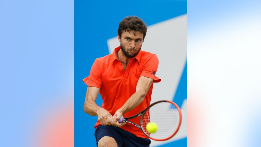 Gilles Simon of France plays a return to Kevin Anderson of South Africa during their semifinal tennis match at the Aegon Championships in London, Saturday, June 20, 2015. (AP Photo/Kirsty Wigglesworth)